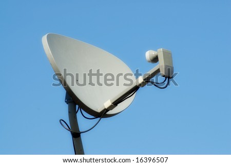 Closeup view of a home satellite shot against blue sky - stock photo