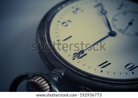 Closeup view of a silver pocket watch. Filtered image:cross processed vintage effect  - stock photo