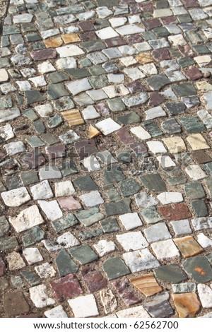 Closeup view of an ancient roman mosaic - stock photo
