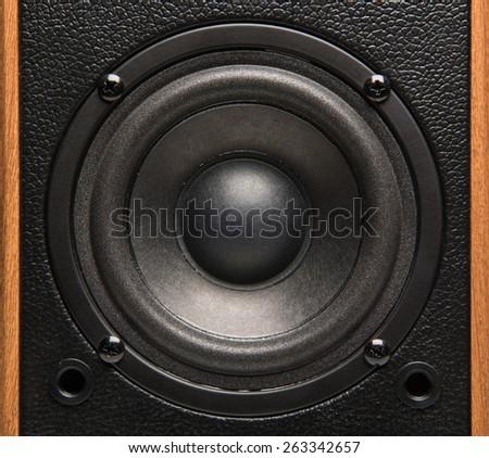 Closeup view of black bass speaker - stock photo