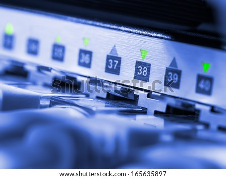 Closeup view of blue toned network hub and cables - stock photo