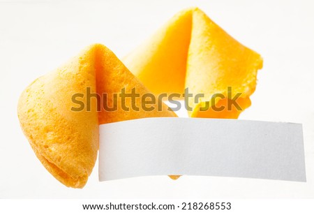 Closeup view of Chinese fortune cookies with a blank note - stock photo