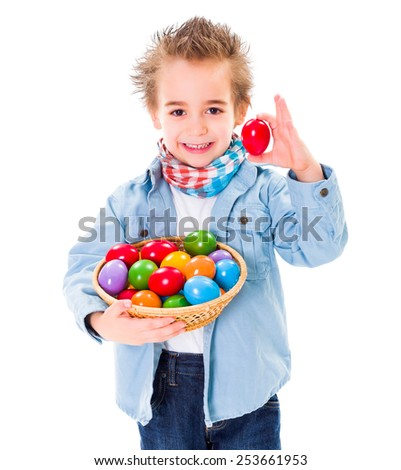 Closeup view of cute little boy showing an red Easter egg - stock photo