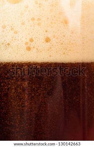 Closeup view of dark beer in the glass - stock photo