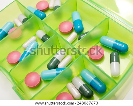 Closeup view of drugs in a box as a weekly dosage or therapy. - stock photo