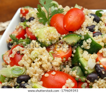 Closeup view of fresh quinoa salad - stock photo