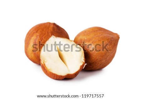 Closeup view of hazelnuts over white background - stock photo