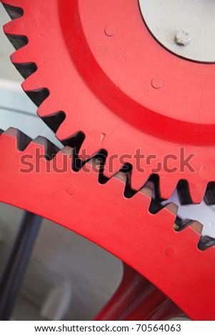 Closeup view of huge cogwheels of the train engine - stock photo