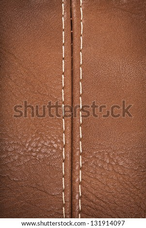 Closeup view of leather material jointed by stitch - stock photo