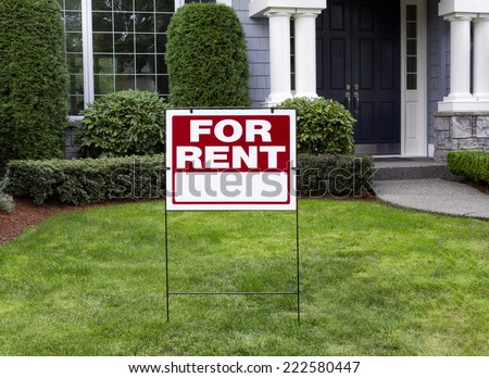 Closeup view of Modern Suburban Home with for Rent Sign in front Yard - stock photo