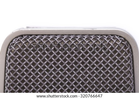 Closeup view of one professional old fashioned aged microphone membrane grey color in studio isolated on white background, horizontal picture - stock photo