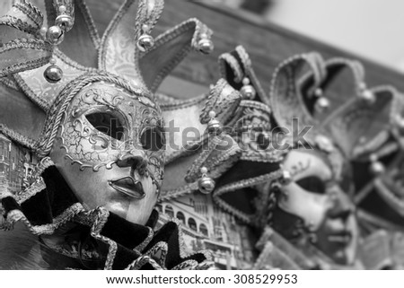 Closeup view of ornate venetian carnival mask with golden pattern. Black and white photography. - stock photo