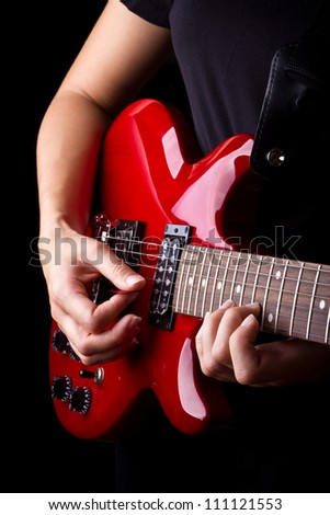 Closeup view of playing electric red guitar - stock photo