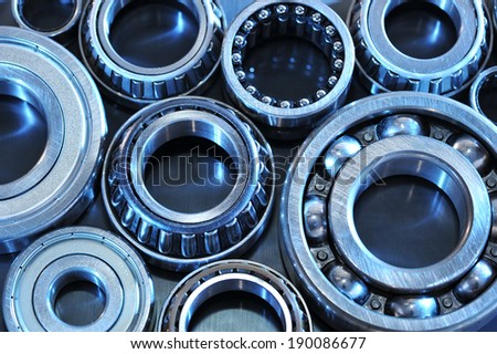 closeup view of several ball-bearings in blue light - stock photo
