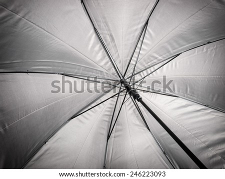 Closeup view of the inner side of an umbrella. - stock photo
