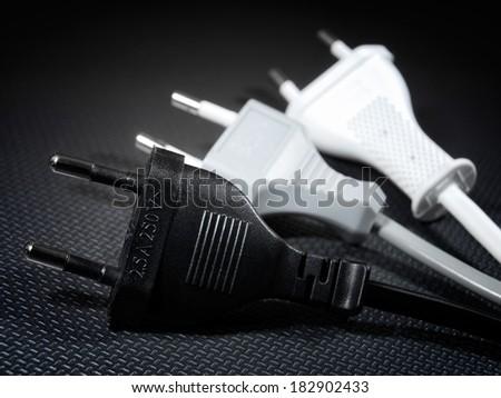 Closeup view of three EU standard electrical plugs. - stock photo