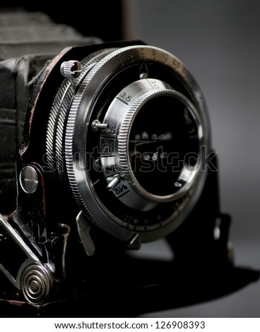 Closeup view of vintage camera in black - stock photo