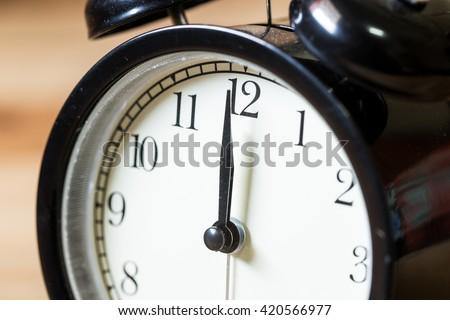 closeup vintage clock selective focus at number 12 o'clock - stock photo