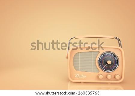 Closeup Vintage Radio on a yellow background - stock photo
