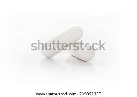 closeup white medicine capsules - stock photo