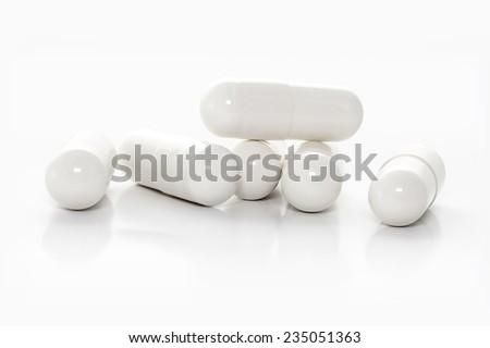 closeup white medicine capsules - stock photo