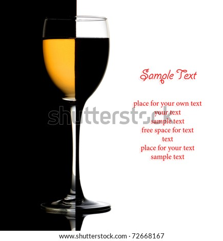 Closeup wine glass over black and white background and space for text - stock photo