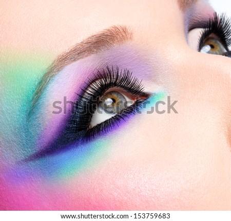 Closeup woman eyes with beautiful  fashion bright blue makeup - stock photo