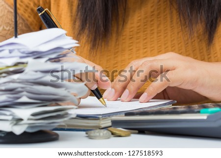 Closeup woman's hand writing messages on business desk - stock photo