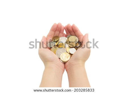 closeup woman's hands holding world coins isolated on white background, human hands and saving concepts - stock photo