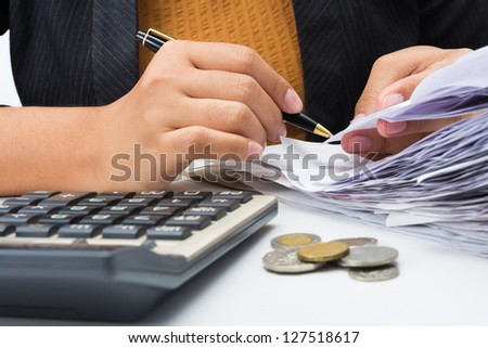 Closeup woman working with receipts - stock photo