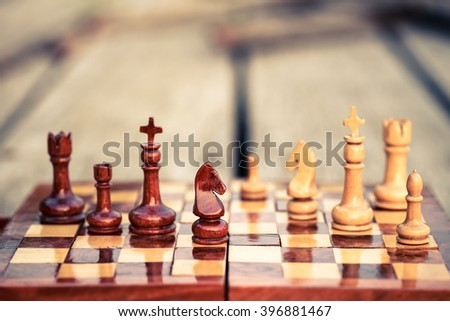 Closeup wood knight chess on chess game board - stock photo