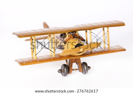 Closeup wooden airplane model flying isolated on a white background - stock photo