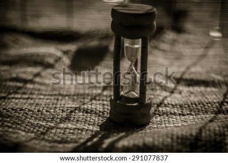 Closeup wooden hourglass ,blur background ,vintage style - stock photo