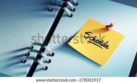 Closeup Yellow Sticky Note paste it in a notebook setting an appointment. The words Schedule written on a white notebook to remind you an important appointment. - stock photo