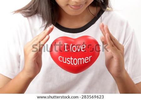 Closeup Young woman hands take care red heart I love customer. - stock photo