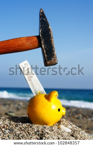 closev up of yellow piggybank with hammer - stock photo