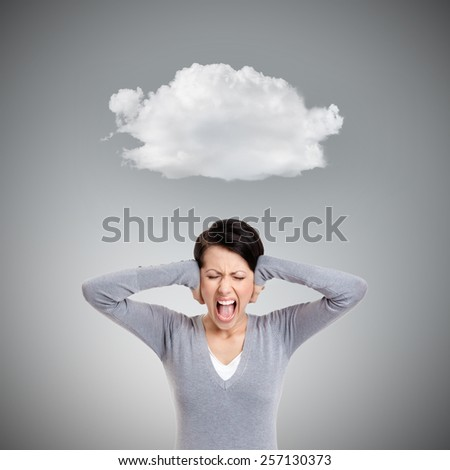 Closing ears with hands and screaming, isolated on grey. Concept of danger - stock photo