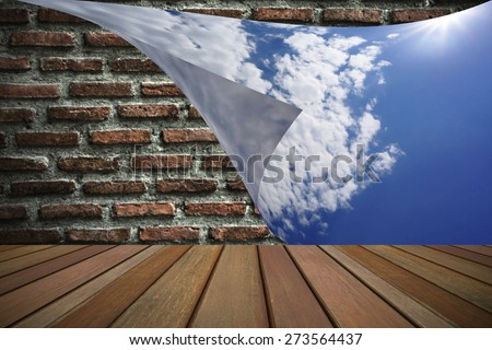 Closing the brick wall with blue sky wallpaper - stock photo