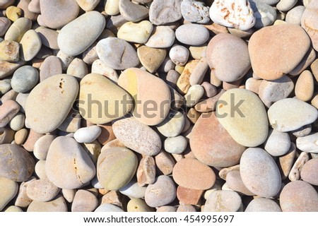 Closup of stones on a pebble beach in Sidmouth - stock photo
