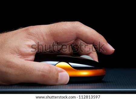 Closupe view of a man's hand and computer mouse. - stock photo