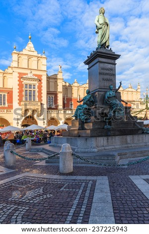 Cloth Hall building and Adam Mickiewicz statue in Krakow, Poland - stock photo