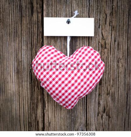 Cloth heart, description field - stock photo