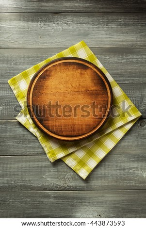 cloth napkin on wooden table background - stock photo