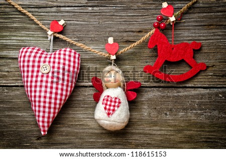 Cloth simple ornament, on wooden background - stock photo