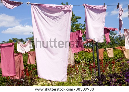 clothes drying on the rope - stock photo