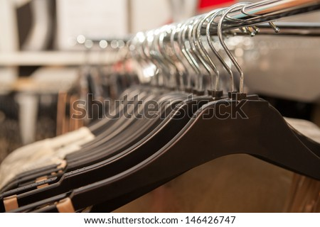 Clothes hang in a boutique store in Melbourne, Australia - stock photo