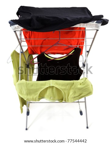 Clothes hanging on a drying rack - alternative to a dryer - stock photo