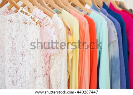 Clothes hanging on the rack - stock photo