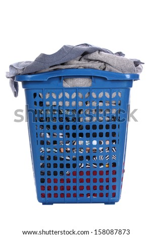 Clothes in a blue laundry basket , Isolated background - stock photo