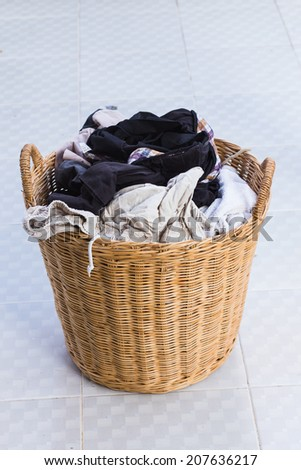 clothes in a wooden laundry basket. - stock photo